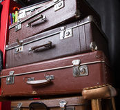 Pile of suitcases. Pile of vintage suitcases on armchair Stock Image