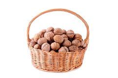 Pile of walnut in basket isolated on white Stock Images