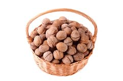 Pile of walnut in basket isolated on white Stock Photography