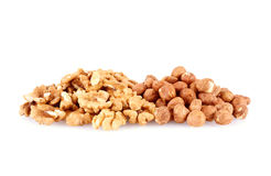 Pile of walnut kerneks and peeled hazelnuts isolated Royalty Free Stock Images