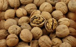 A pile of walnut and the walnut shell breaking Royalty Free Stock Photo