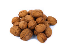 Pile of walnuts. Isolated over white background Royalty Free Stock Photography