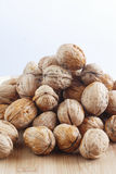 Pile of walnuts. Stack of walnuts on a wooden table Stock Photography