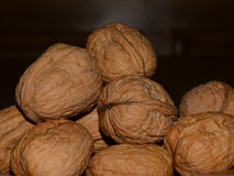 Pile of walnuts. Against a dark background stock photos