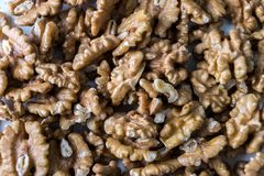 Pile of walnuts on a white table. Close up view. Nuts for health.  stock photos