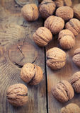 Pile of walnuts  on a wooden background Stock Images