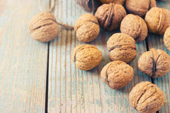 Pile of walnuts  on a wooden background Royalty Free Stock Photo
