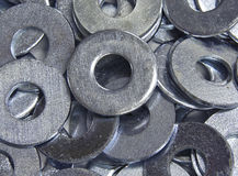 Pile of Washers. A pile of zinc plated flat washers royalty free stock images