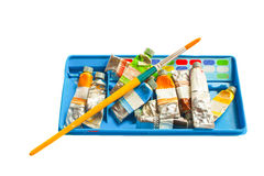 Pile of water color in container and brush Royalty Free Stock Image