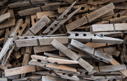 Weathered wooden pegs. Pile of weathered vintage wooden spring pegs Royalty Free Stock Photos