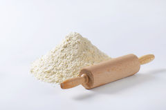 Pile of wheat flour and rolling pin Stock Photos