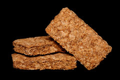 Pile of wheatabix cereal. On black background Stock Images