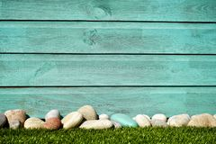 Pile of White and Blue Stones in Front Blue Painted Wall Stock Image