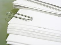 Pile of white bond paper with metal paper clip Royalty Free Stock Image