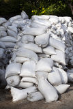 Pile of white cloth sand bags waiting Stock Photo