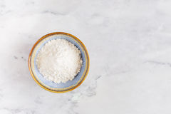A pile of white flour in bowl royalty free stock photos