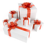 Pile of white gifts. With red ribbons isolated on white and with clipping path Royalty Free Stock Photo