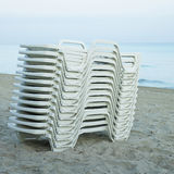 Pile of white lounging chairs Stock Image