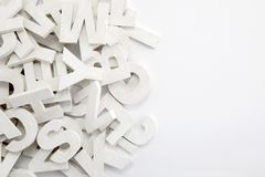 Pile of white painted wooden letters Royalty Free Stock Images