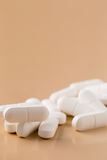 Pile of white pills Royalty Free Stock Photo
