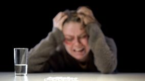 Pile of white pills and water glass table, hopeless violence victim background. Stock photo stock photo