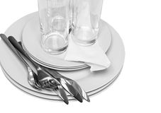 Pile of white plates, glasses, forks, spoons. Royalty Free Stock Photography