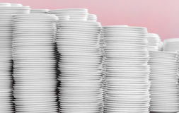 Pile of white plates in warehouse. Stock Photography