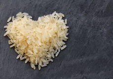 Pile of white  rice in heart Royalty Free Stock Photo