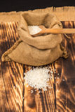 A pile of white rice sitting on a brown burlap Stock Photos