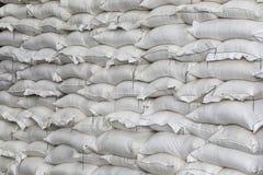 Pile of white sacks in warehouse Royalty Free Stock Photo