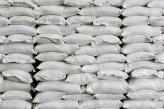 Pile of white sacks in warehouse Stock Photo