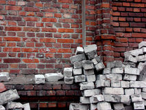 Pile of white silicate bricks near red brick wal Stock Photos