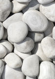 Pile of white stones for background or texture. Close-up of the white pebbles, white rocks stock photo