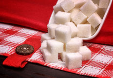 Pile of white sugar cubes on a  linen tablecloths Stock Photo