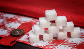 Pile of white sugar cubes on a  linen tablecloths Royalty Free Stock Photography