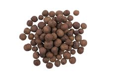A pile of whole allspice, jamaica peppe. Isolated on white background royalty free stock photo