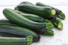 Pile of whole courgettes  on white weathered wood. Stock Photography