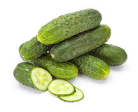 Pile of whole and sliced cucumbers (Cucumis sativus) Royalty Free Stock Photos