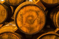 Pile of wine barrels. Wine barrels stacked in the old cellar of the winery stock photo