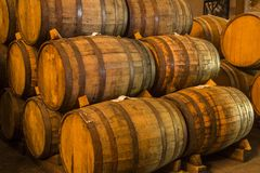 Pile of wine barrels. Wine barrels stacked in the old cellar of the winery royalty free stock photos