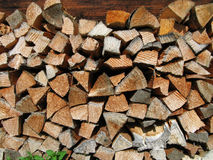 Pile of wood. In front of old house Stock Photos