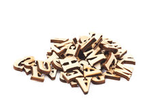 Pile of wood carved letters isolated Royalty Free Stock Photo