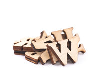 Pile of wood carved letters isolated. Over the white background Royalty Free Stock Images