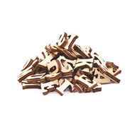 Pile of wood carved letters isolated Stock Images