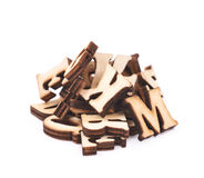 Pile of wood carved letters isolated. Over the white background Stock Photography