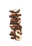 Pile of wood carved letters isolated. Over the white background Royalty Free Stock Photography