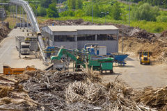 Biomass in power station. Pile of wood for combustion in a biomass boiler Stock Photo