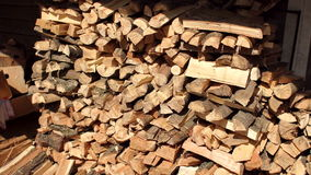 Pile of wood cut for fireplace. Wooden background. stock video