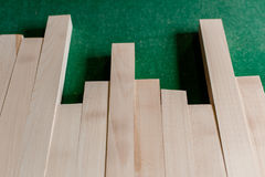 Pile of wood in different dimension. Pile of wood in different dimension, on green backgroung in a manufacture factory Stock Image