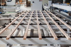 Pile of wood in different dimension. Wood sticks on a furniture manufacture production machine Royalty Free Stock Photo